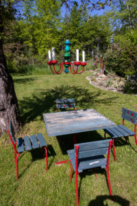 With great attention to detail Bill and Dawn have designed their garden - as here in the picnic area.