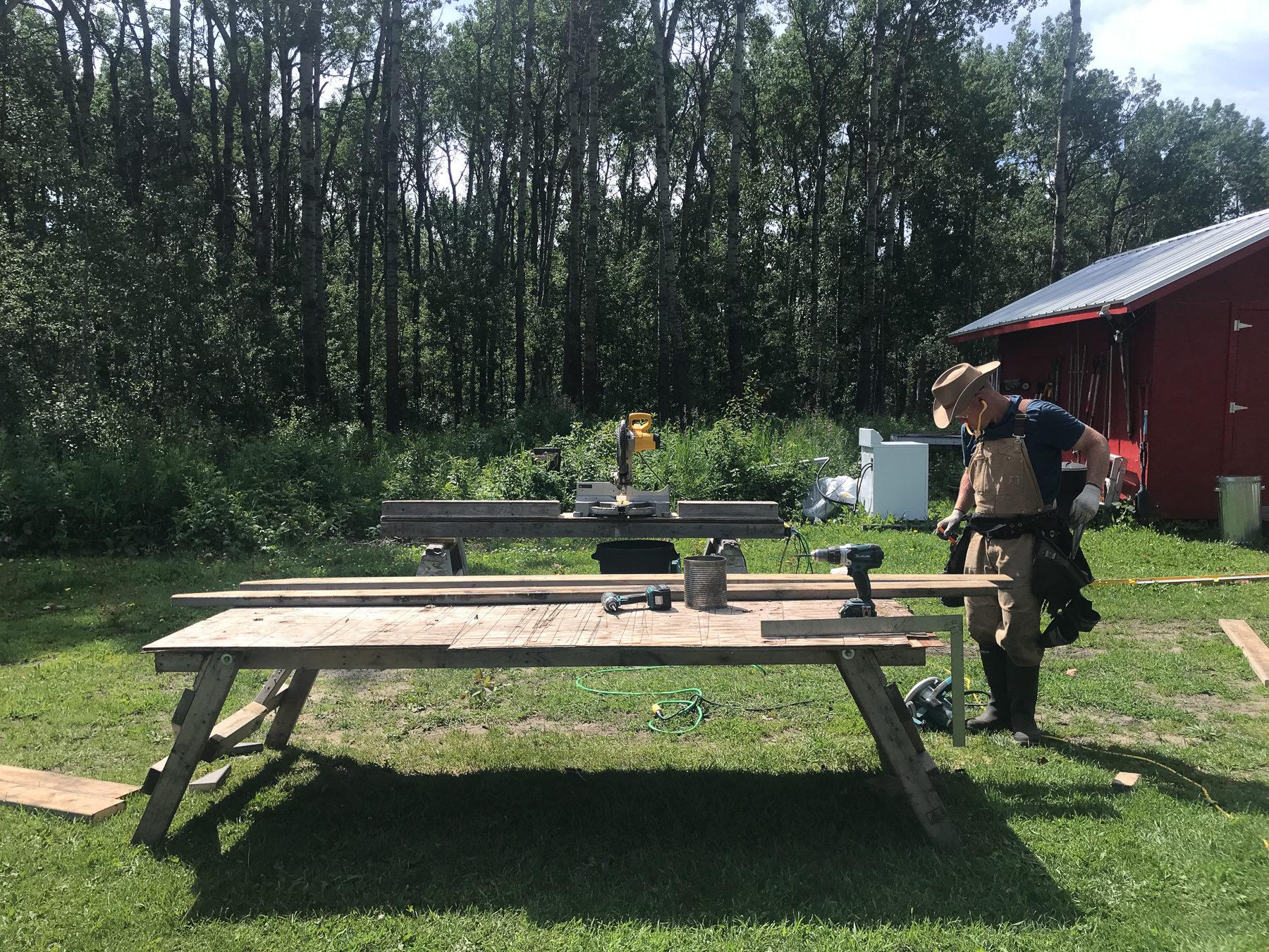 Guy has set up his outdoor workshop.