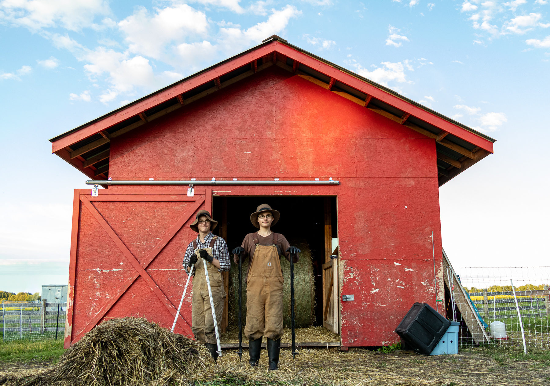 Gabriel and Paul in front of the barn. Here they pause during their evening chores.