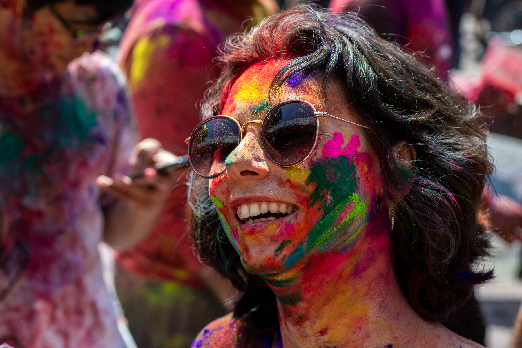 Colorful and happy faces at the Holi Festival in Rishikesh. The happy partying could help the virus spread faster.
