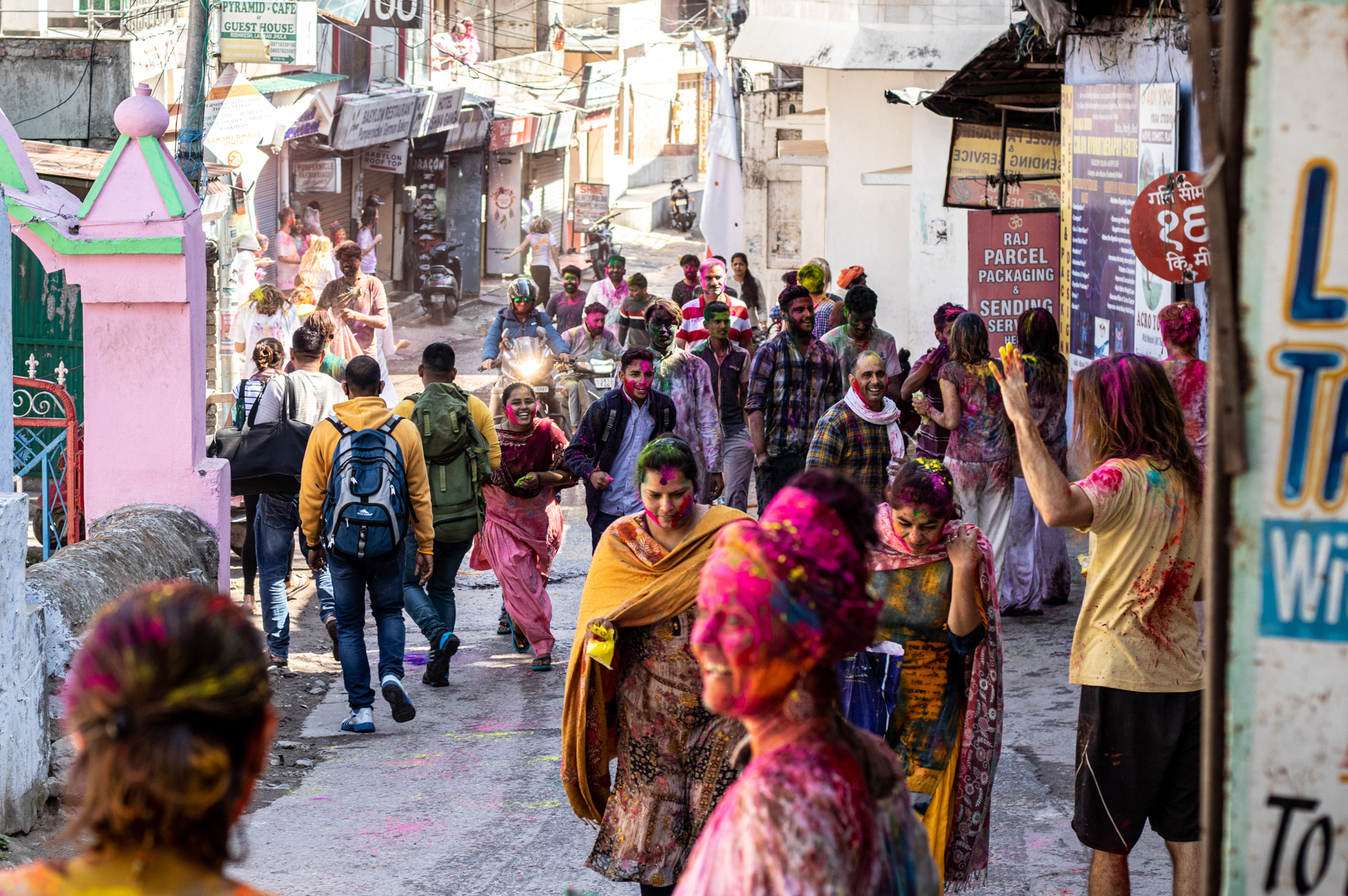 Happy faces during the colorful Holi festival in the streets of Rishikesh.